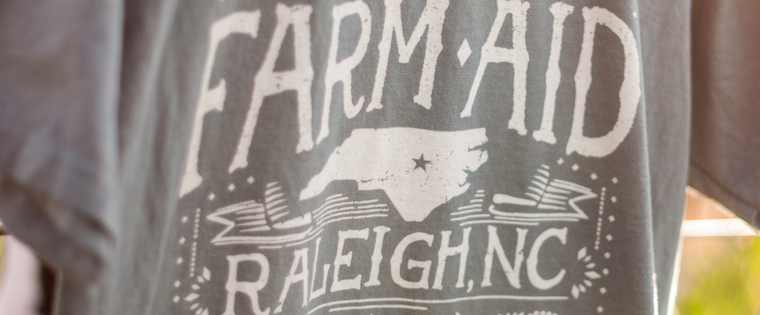 N.C. Organic Cotton T-Shirt Headlines Farm Aid's Merchandise Table This Year