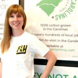 Jesika shows off our Faith in Humanity t-shirt at TS Designs.