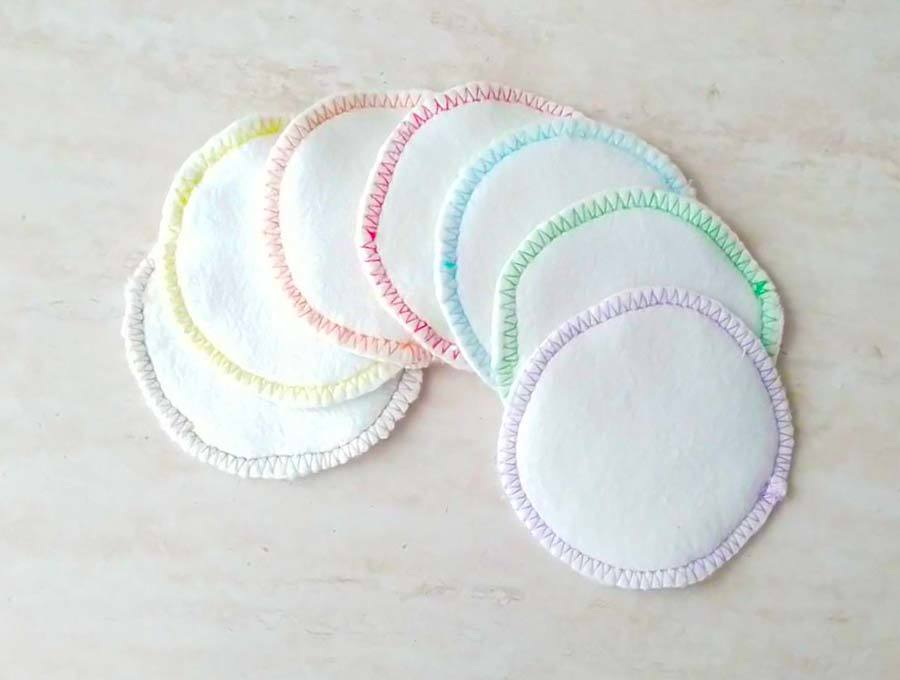 A picture of seven round cotton pads